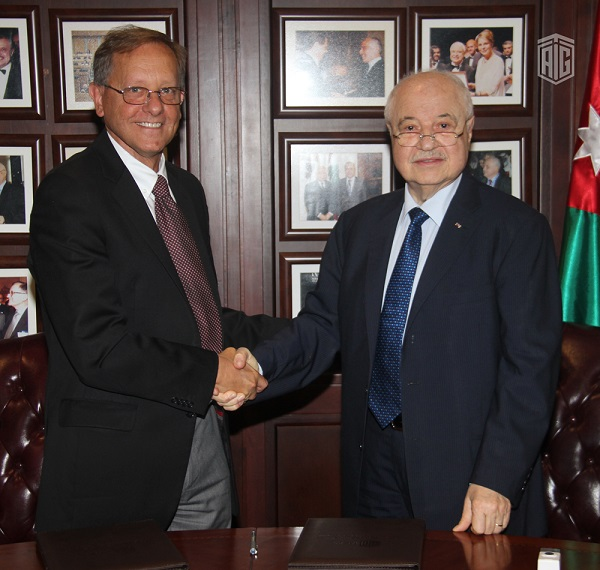 HE Dr. Talal Abu-Ghazaleh, and Mr. Roger Davies, Director of UNRWA Operations in Jordan, agree on capacity building programs for Palestinian refugees.
