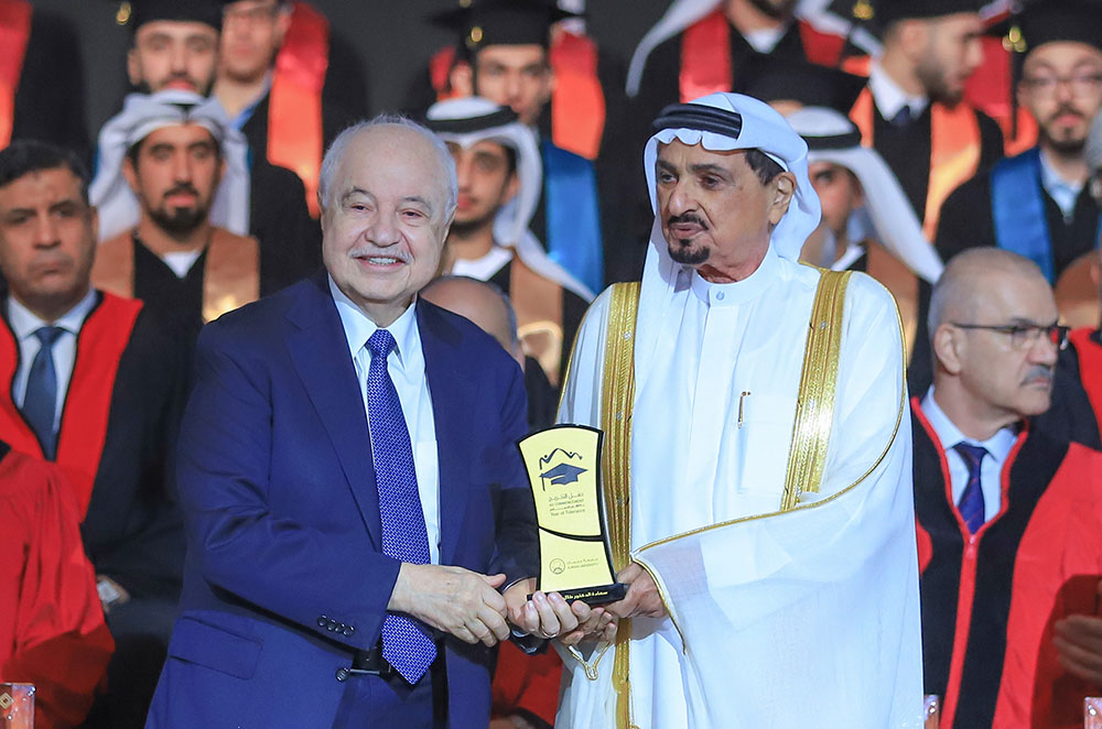HE Dr. Talal Abu-Ghazaleh receives an honorary shield from His Highness Sheikh Humaid Al Nuaimi