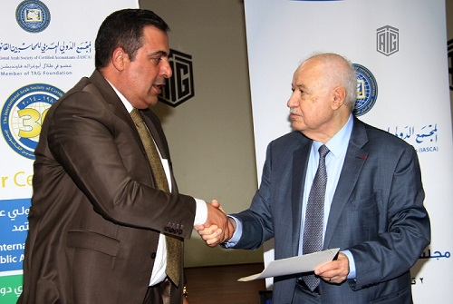 HE Dr. Talal Abu-Ghazaleh signs a cooperation agreement between IASCA and Iraq's Bayt Al-Hikmah